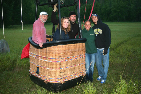 Balloon pilots Damien Mahony and Keely Wade with passenger Jay Davis prepare to launch from the Stratobowl.